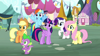 Main ponies and Spike look toward Pinkie S8E18