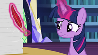 Twilight Sparkle looking at her broken quill S7E22