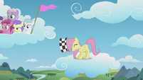 Filly Fluttershy waves the checkered flag S5E25