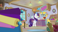 Rarity buying fabric at a fabric store S9E19