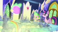 Twilight and Spike look at the glowing Cutie Map S7E15
