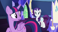 Twilight looks at Rarity's cutie mark S5E16