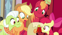 Apple family looking at scroll S4E09