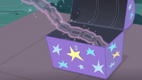 Chains levitating out of a supply trunk S7E24