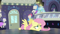 Fluttershy falls over onto the floor S8E4