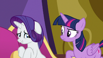 Rarity giving Twilight a nervous smile S9E19