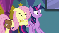 Fluttershy pushing Twilight toward the door S7E20