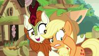 Applejack rubbing her sore cheeks S8E23