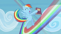 Rainbow Dash flying around with her book S4E22