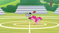 Spike bumps the ball toward Fluttershy S8E24