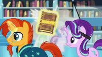 Starlight and Sunburst walk past Twilight, Celestia, and Spike S7E1