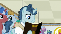 Student 1 reading a textbook S8E16
