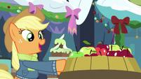 Applejack pushing a barrel of apples MLPBGE
