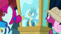 Gallus gestures toward museum exhibits S9E3