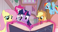 Mane Six looking at the EEA guidebook S8E1