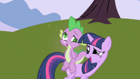 Spike dizzy on Twilight's back S1E01