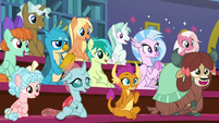 Students applauding for Professor Rockhoof S8E21