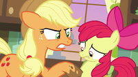 AJ prodding Apple Bloom with a muddy hoof S7E13