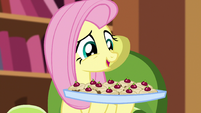 Fluttershy holds up a tray of teacakes S5E7