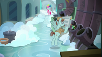 Janitor Pony throws out trash in a disposal tube S7E23