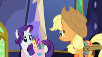 Rarity and Applejack look at each other S6E21