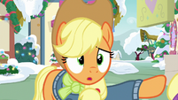 Applejack pushing Fluttershy's hoof away MLPBGE