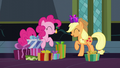 Applejack with a gift; Pinkie eating a cupcake S6E8.png