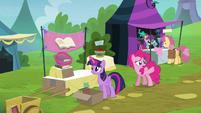 Pinkie Pie pointing toward royal box seats S4E22