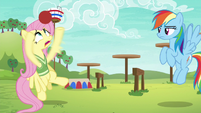 Fluttershy struggles to grab the softball S6E18