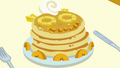 Plate of peach and pineapple pancakes S7E10.png
