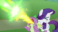 Spike protects Rarity with fire breath S9E25