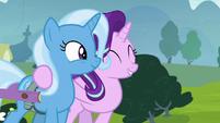 Starlight puts a hoof around Trixie S8E19