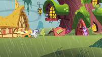 Applejack and Rarity gallop to the library S1E08