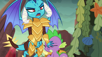 Ember pushing Spike out of the way S6E5
