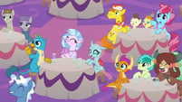 Young Six and friends cheer at coronation S9E26