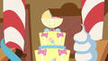 Close-up on stroller-shaped cake topping S5E19.png