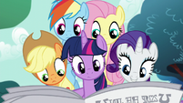 Main five reading the Foal Free Press S5E19