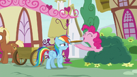 Pinkie Pie gives Rainbow Dash a custard pie S7E23