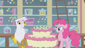 Pinkie and Gilda smiling by the cake S1E05.png