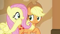 Fluttershy whispering to Applejack S6E20