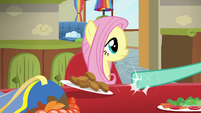 Zephyr pushing Fluttershy's lunch plate aside S6E11