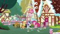 AJ, Rarity, Pinkie, and Spike behind Sugarcube Corner S7E9.png