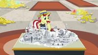 Flam looks at model of Las Pegasus resort S8E16