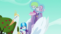 Rarity levitates Sweetie Belle onto the cart S6E14