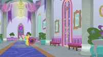 Citrine Spark walks through school hallway S9E4