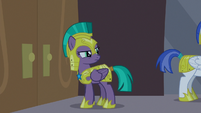 Guard Chrysalis looks at guards behind her S9E17