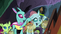 Ocellus and changelings holding lanterns S8E16