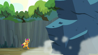 Smolder running toward the giant rock S9E3