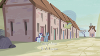 Two ponies standing and smiling in front of a house S5E02