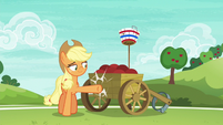 Applejack lightly kicking the ball cart S6E18